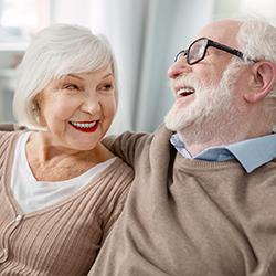 Elderly women embracing